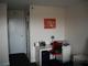 Single person rental bedroom work area