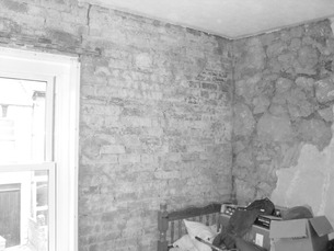 Damp walls with plaster crumbled away.