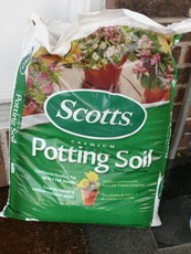 Scotts Potting Soil to refill the planters after we emptied them from the old dirt