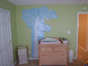 Deciding on wall placement of tree. Tree came in 4 parts.