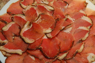Sliced capicola ready to be served to friends and family.  A Salute!