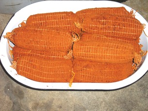 Seasoned and netted prepared loin ready for hanging