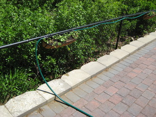 Multiple garden hoses can be used for a long run.