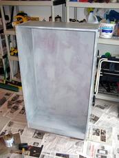 Book case painted with primer.